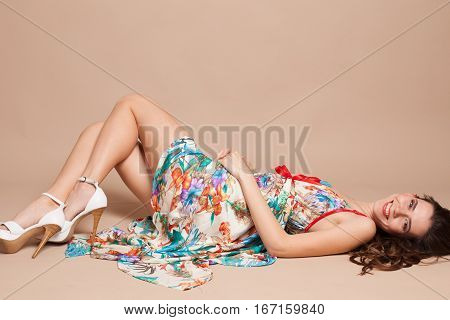 beautiful girl in colored dress lying on the floor