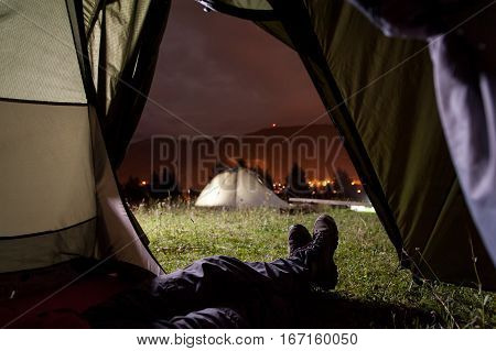 Hiker Lying In Tent With View Of Camping, Mighty Mountains
