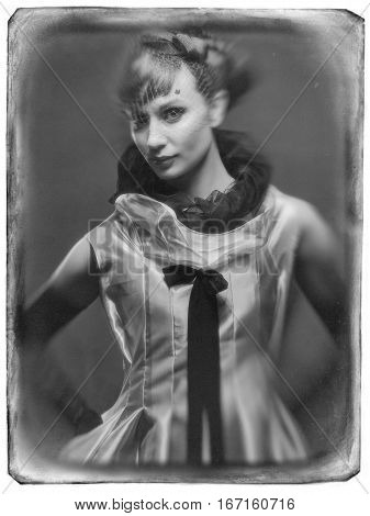 Young girl in the Studio on a swing.Girl swinging on a swing in the Studio in the expensive evening dresses. Grunge film framed. Black and white pictures.