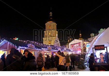 KYIV, UKRAINE - DECEMBER 28, 2014: St. Sophia Cathedral Christmas market and main Kyiv's New Year tree on Sophia Square in Kyiv, Ukraine