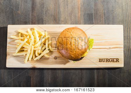 Crafting A Burger On The Board With Fries