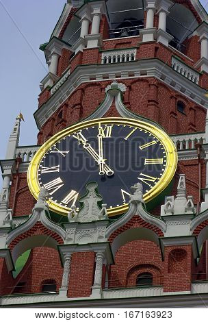 dial mechanical clock on the Spasskaya tower of the Moscow Kremlin close up in summer