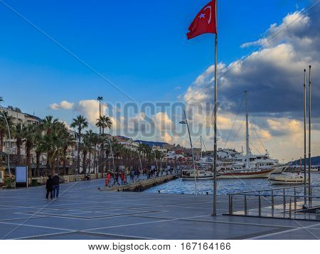 Marmaris street with turkish flag in city center.