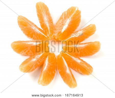 slices of tangerine disclosed in the form of a flower isolated on white background.
