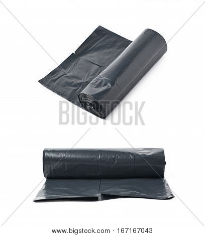Black plastic polyethylene trash bag roll isolated over the white background, set of two different foreshortenings