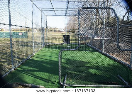 local high schools batting cage from behind the pitchers safety screen