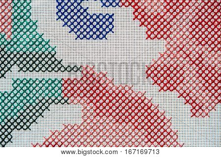 Detail of cross stitch embroidery. Abstract background in blue, red, green and pink threads.
