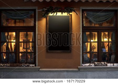 Empty Sign Board For Advertising Text. Christmas Luxury Decorated Store Front With Garland Lights In