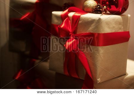 Pile Of Gift Boxes  Wraped In Craft Paper With Red Ribbons. Christmas Presents Concept. Winter Holid