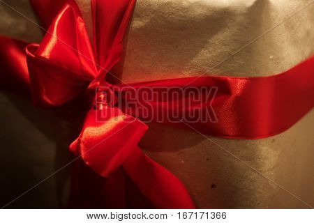 Gift Box Wraped In Craft Paper With Red Ribbons. Christmas Presents Concept. Winter Holidays. Season