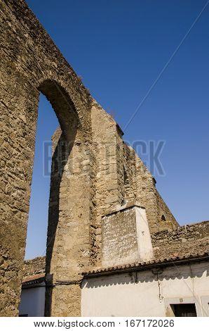 view of the Evora aqueduct a roman empire heritage unesco heritage site.