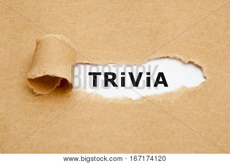 The word Trivia appearing behind torn brown paper.