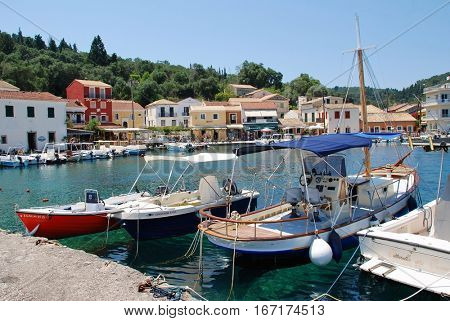 PAXOS, GREECE - JUNE 11, 2014: Small boats moored in the harbour at Loggos on the Greek island of Paxos. The 13km long Ionian island has a population of around 2300 people.