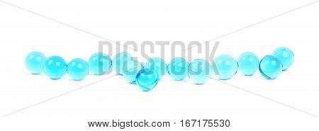 Line of blue soil water beads isolated over the white background