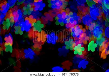 flower bokeh effect dark black background red green blue