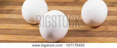 Chicken eggs on a wooden background this product is very useful and nutritious containing protein