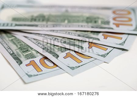 Background of american hundred dollar bills.  focus on numbers one hundred of cash  money