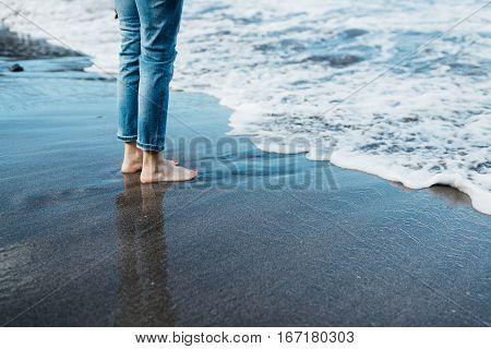 Female feet with pedicure in Tenerife beach sand. Los Gigantes Puerto de Santiago Tenerife Canary Islands