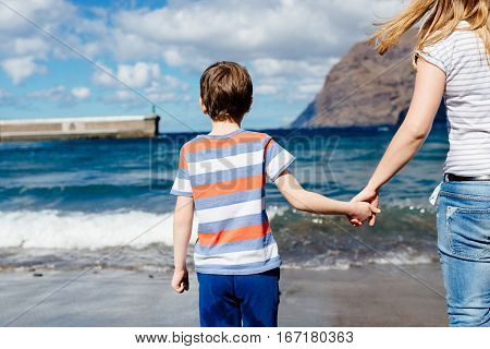 Happy Child And His Mother On Beach