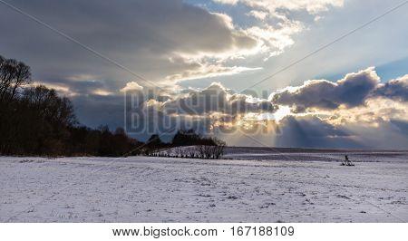 Sunbeams shining through dense clouds. Moravian landscape Sudice.