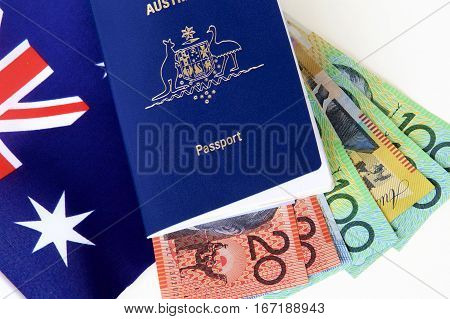 Australian passport ready for travel with cash and a flag.