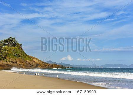 Waves and stones on Devil's beach in Ipanema Rio de Janeiro