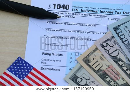 US tax form dollar cash pen calculator finance accounting and tax season concept