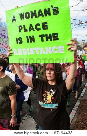 ATLANTA, GA - JANUARY 2017:  A woman carries sign that says