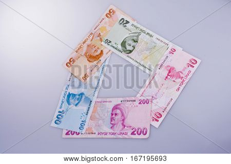Turksh Lira banknotes of various color pattern and value on white background