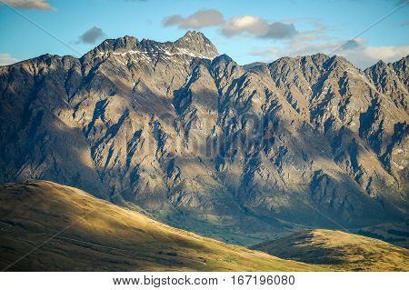 View of a sunlit mountain range from Bob`s Peak above Queenstown on the South Island of New Zealand