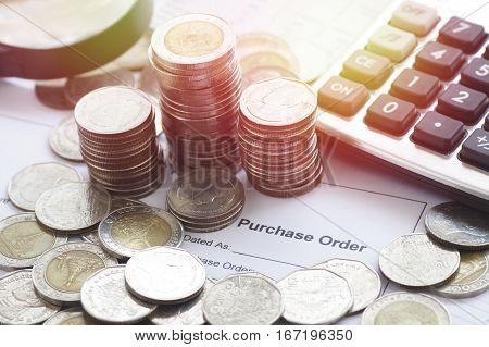 purchase order with calculator and money coins concept in account and business