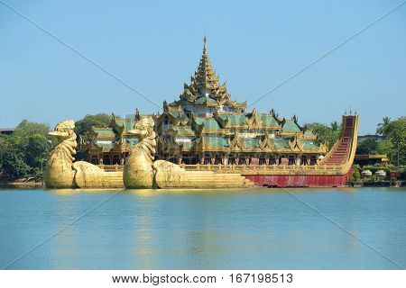 YANGON, MYANMAR - DECEMBER 18, 2016: The copy of the royal barque Karaveyk on the artificial lake Kandodzhi in the center of Yangon