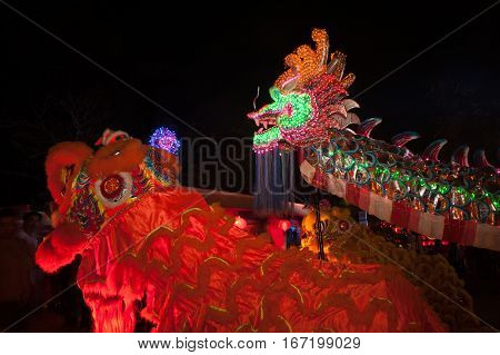 Lighting Head Dragons and Lions are showing in Chinese new year festival in Thailand.