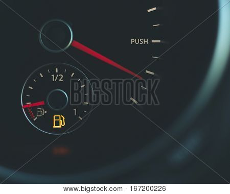 Conceptual image Push Running on empty fuel gauge speedometer