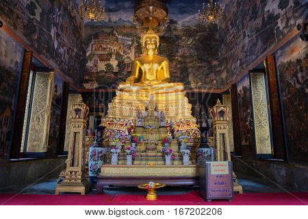 BANGKOK, THAILAND - JANUARY 06, 2017: The altar with the sculpture of a seated Buddha in the bot of Wat Wihan Bovornniwet