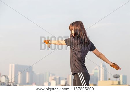 Asian Woman Fitness Sunrise Stretch Before Jogging Workout Wellness Concept.