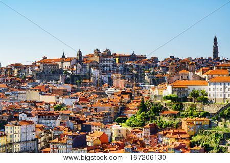 Beautiful View Of Tile Roofs Of Houses In The Historic Centre Of Porto On The Blue Sky Background In