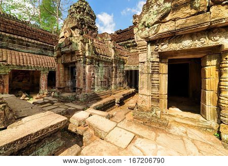 Mossy Buildings With Carving Of Ancient Preah Khan, Angkor