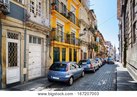 Colorful Facades Of Old Houses On The Street Of The Historic Centre Of Porto, Portugal.