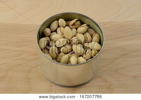 Raw pistachio nuts in shells in opened can