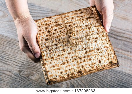 Jewish matza on Passover in hand. Traditional Jewish food