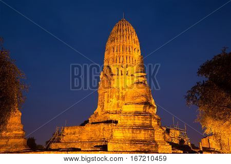 Ancient prang Buddhist temple of Wat Ratcha Burana in night illumination Ayutthaya, Thailand