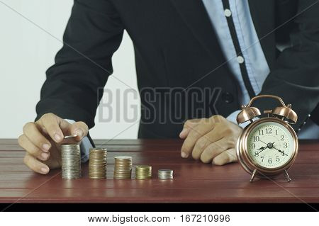 money hand man business coin stack finance concept investment growth currency cash banking coins pile white wealth rich businessman putting financial stock savings gold bank growing finger economy earnings market save loan income pound rising success