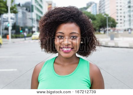 Cute young woman from Africa in city in the summer