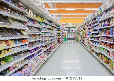 BANGKOK THAILAND - Dec 6 2016 : Aisle view of a Tesco Lotus supermarket. Tesco is the world's second largest retailer with 6531 stores worldwide.