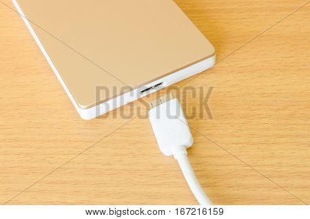 External hard drive on wood table .