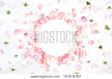 Frame made of pink roses petals on white background. Flat lay top view. Valentine's background