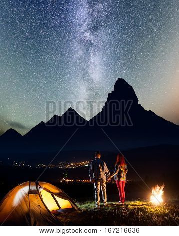 Night Camping. Charming Hikers Family - Man And Woman Holding Hands, Standing Near Camp And Enjoying