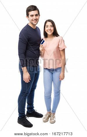 Full length portrait of a good looking young couple with a credit card ready for some shopping