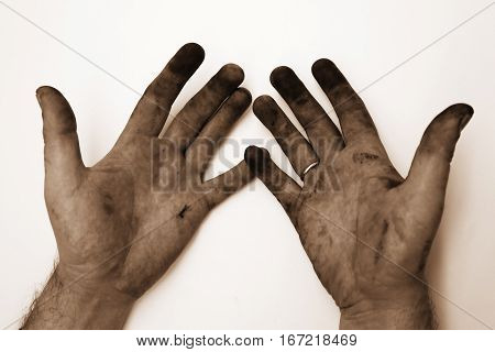 Dirty hands of a man on a white background